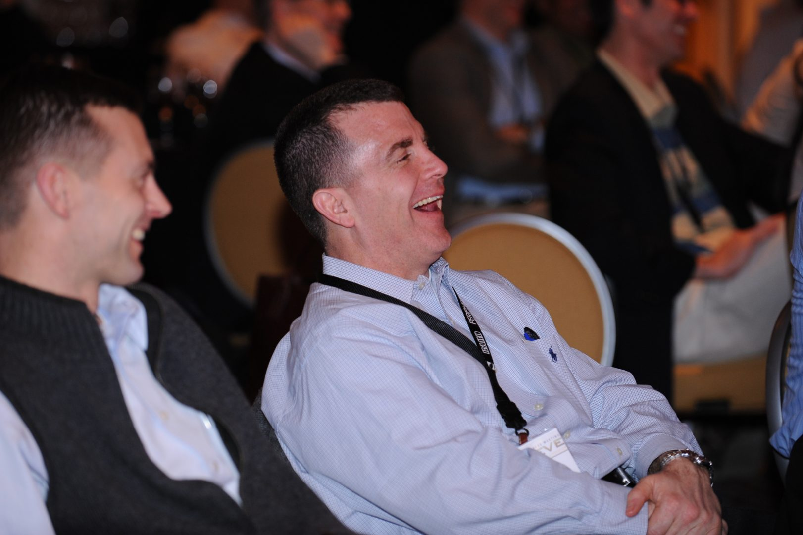 man at conference laughing